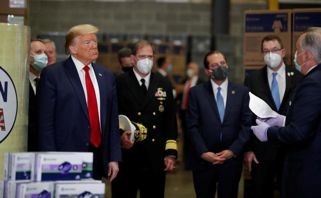 Without wearing a mask, Trump tours Pennsylvania mask distribution ...