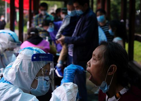 Fearing a second wave, Wuhan ramps up virus tests