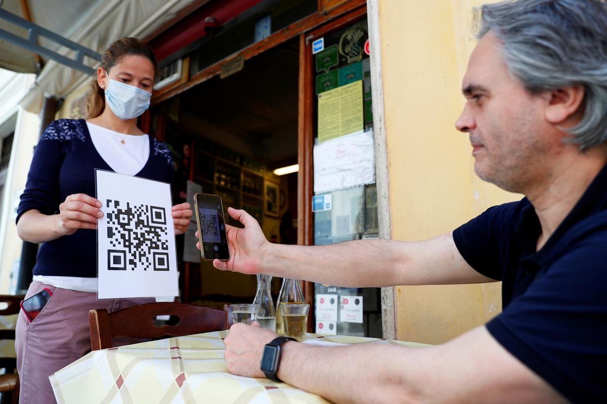 'Here's your scan code for tonight': Italy eatery rips up paper menus