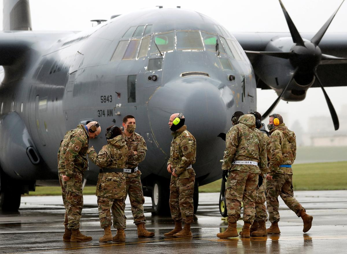 U.S. masses planes at Japan base to show foes and allies it can handle coronavirus