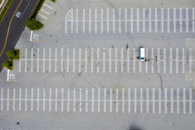 Parking lots stand empty at the King of Prussia Mall which remains closed due to the ongoing outbreak of the coronavirus disease (COVID-19) in Upper Merion Township, Pennsylvania U.S., May 21, 2020. REUTERS/Lucas Jackson