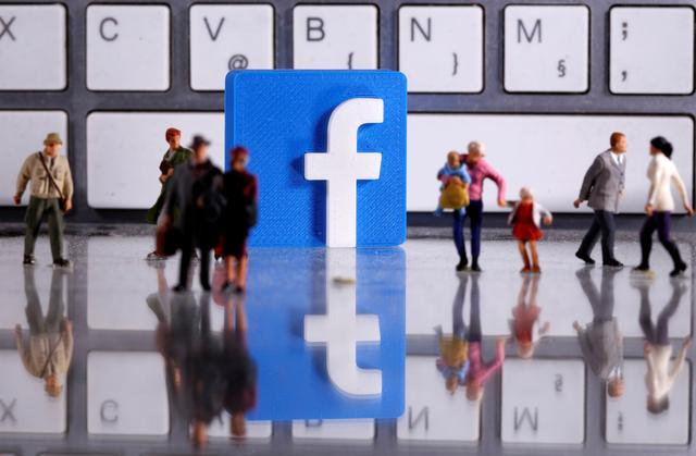 FILE PHOTO: A 3D printed Facebook logo is placed between small toy people figures in front of a keyboard in this illustration taken April 12, 2020. REUTERS/Dado Ruvic/Illustration/File Photo