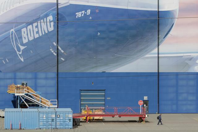 FILE PHOTO: A worker leaves the Boeing Everett Factory, amid the coronavirus disease (COVID-19) outbreak, in Everett, Washington, U.S. March 23, 2020.  REUTERS/David Ryder/File Photo