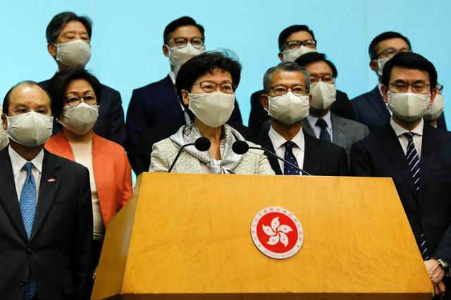 FILE PHOTO: Hong Kong Chief Executive Carrie Lam, wearing a face mask following the coronavirus disease (COVID-19) outbreak, attends a news conference with officers over Beijing's plans to impose national security legislation in Hong Kong, China May 22, 2020. REUTERS/Tyrone Siu