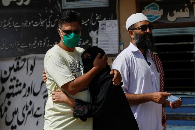 Family members mourn the death of a relative who was killed in a plane crash, outside a morgue in Karachi, Pakistan May 23, 2020. REUTERS/Akhtar Soomro