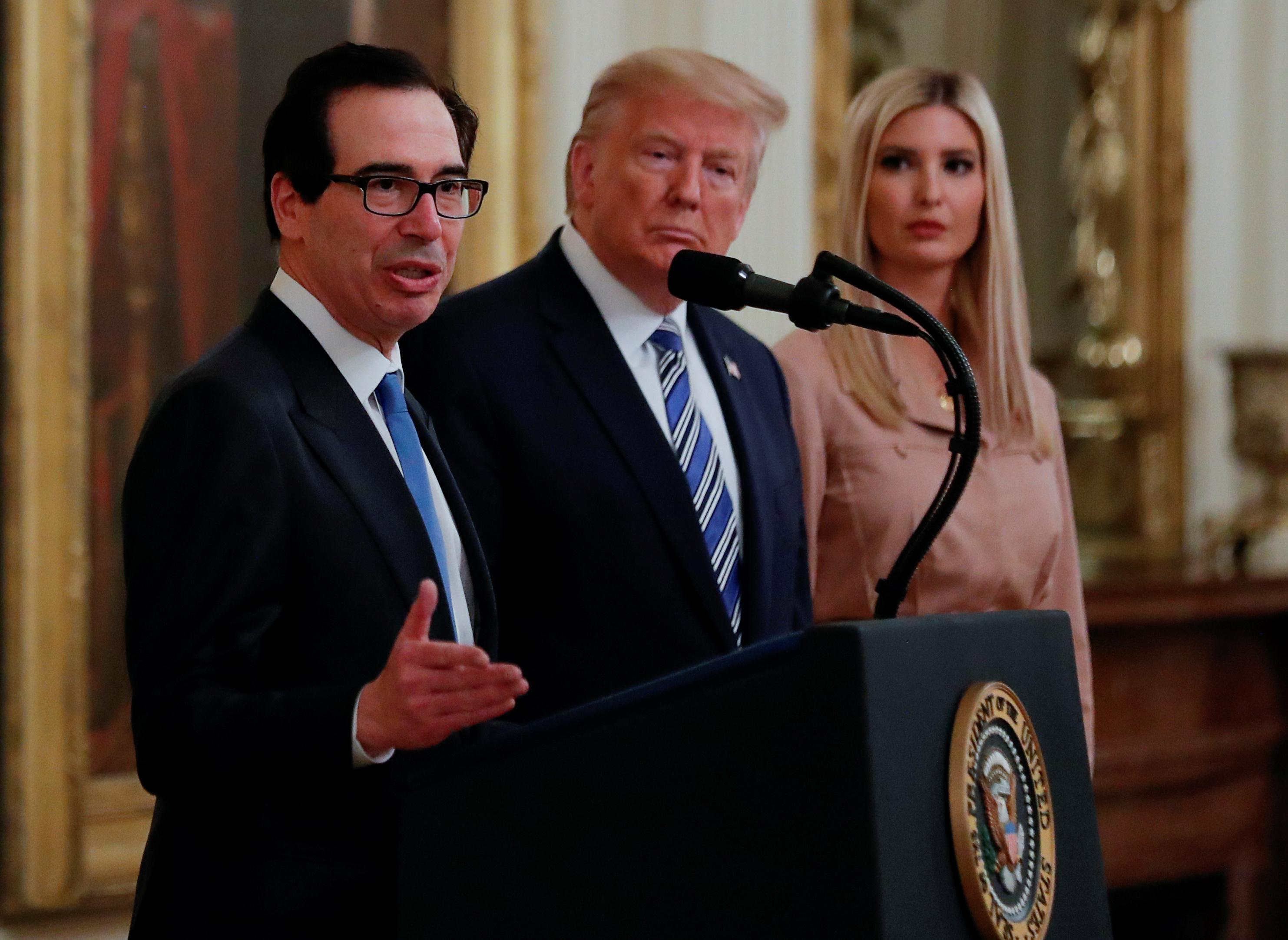 Treasury Secretary Steven Mnuchin speaks as U.S. President Donald Trump and White House senior adviser Ivanka Trump listen during an East Room event highlighting Paycheck Protection Program (PPP) loans for small businesses adversely affected by the coronavirus disease (COVID-19) outbreak, at the White House in Washington, U.S., April 28, 2020. Carlos Barria