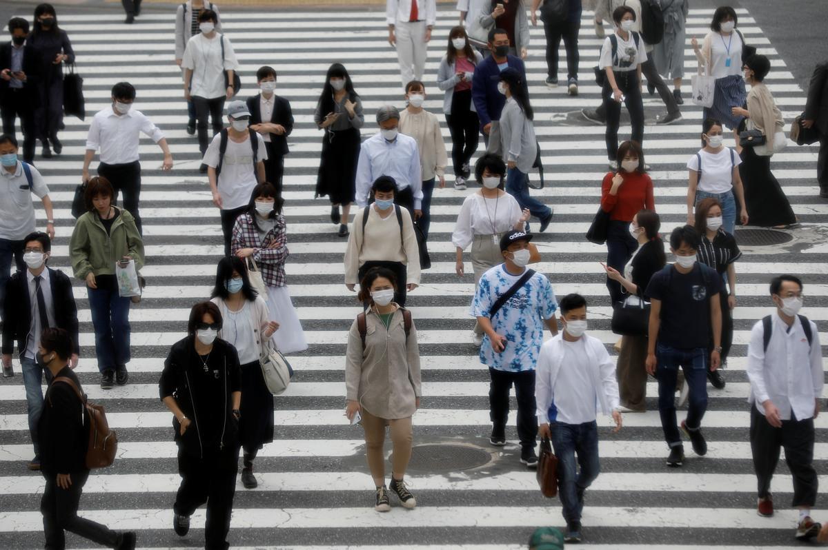 Japan approves fresh $1.1 trillion stimulus to combat pandemic pain