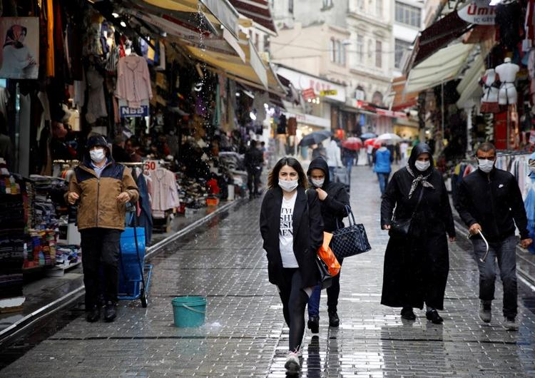 UPDATE 2-Grand Bazaar, cafes open and flights resume as Turkey eases up