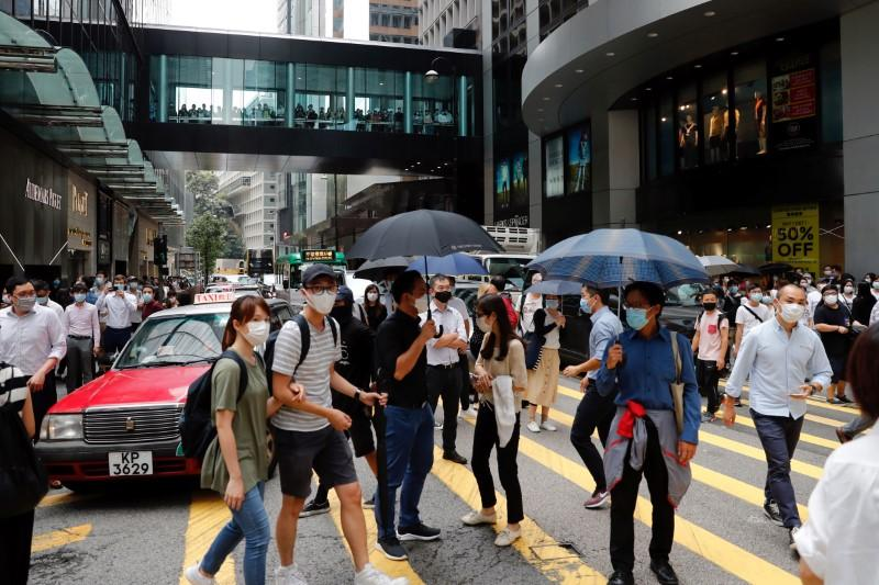 Tensions simmer in Hong Kong as controversial anthem law back up for debate 62