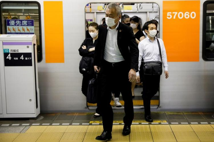 Japan's 'mosh pit' trains spark fear of new coronavirus cases