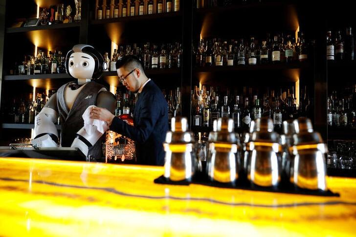 A robot walks into a bar, helps make a cocktail