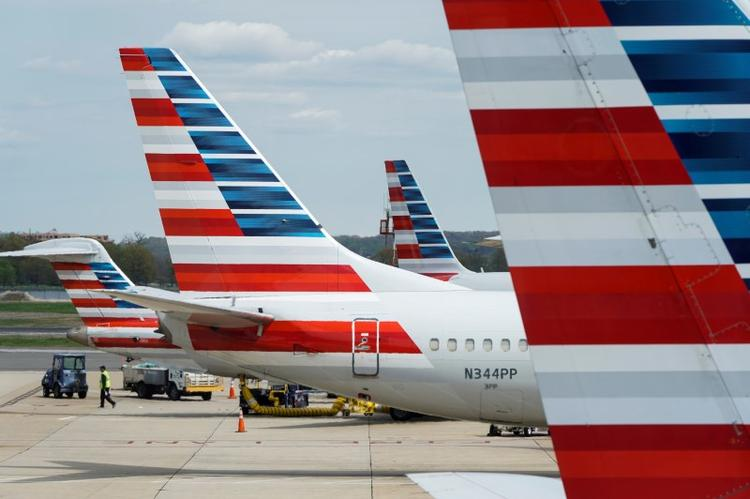 UPDATE 1-American Airlines soars on news it will boost U.S. flights in July