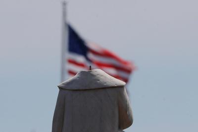 Christopher Columbus statues burned, beheaded and torn down