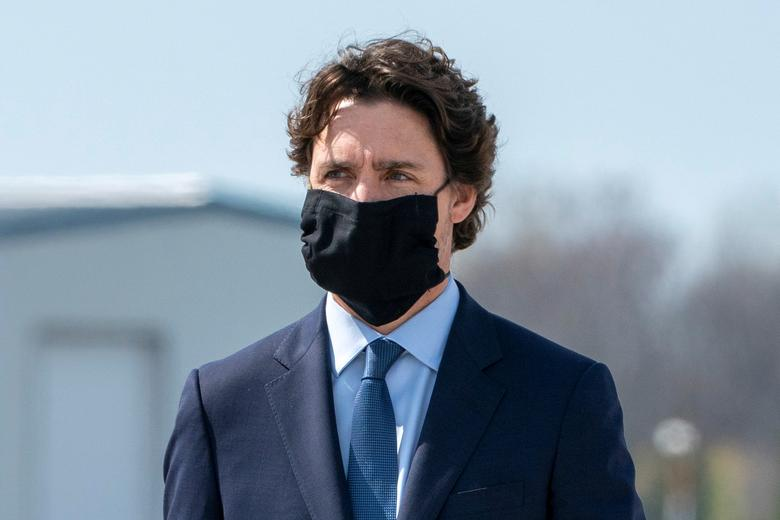 Canada's Prime Minister Justin Trudeau attends a repatriation ceremony at Canadian Forces Base in Trenton, Ontario, May <span dir=