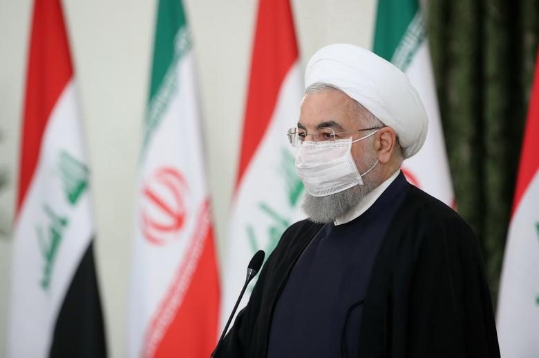 Iranian President Hassan Rouhani attends a news conference in Tehran, July <span dir=