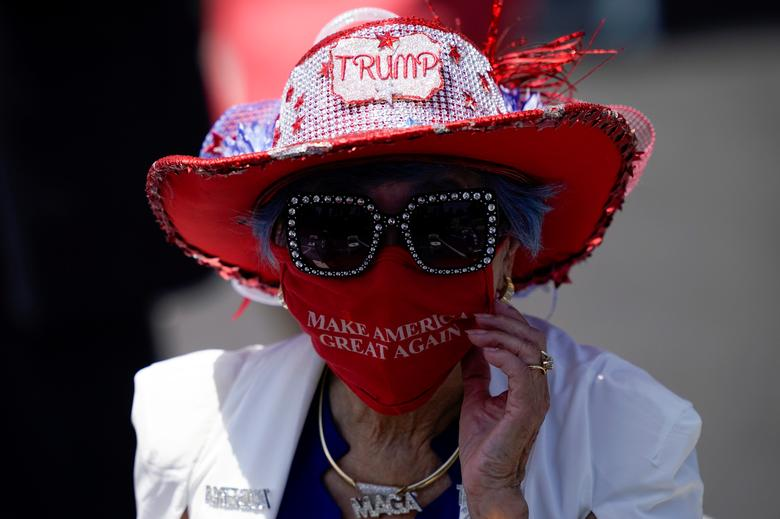 Betty Chu adjusts her face mask before watching Secretary of State Mike Pompeo speak at the Richard Nixon Presidential Library, Thursday, July 23, 2020, in Yorba Linda, California. Ashley Landis/Pool via REUTERS