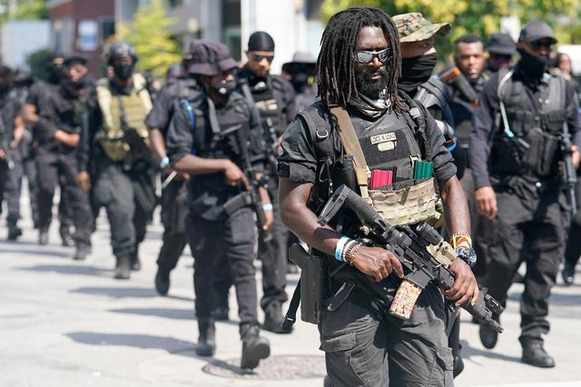 Black armed protesters march in Kentucky demanding justice for Breonna Taylor | Reuters