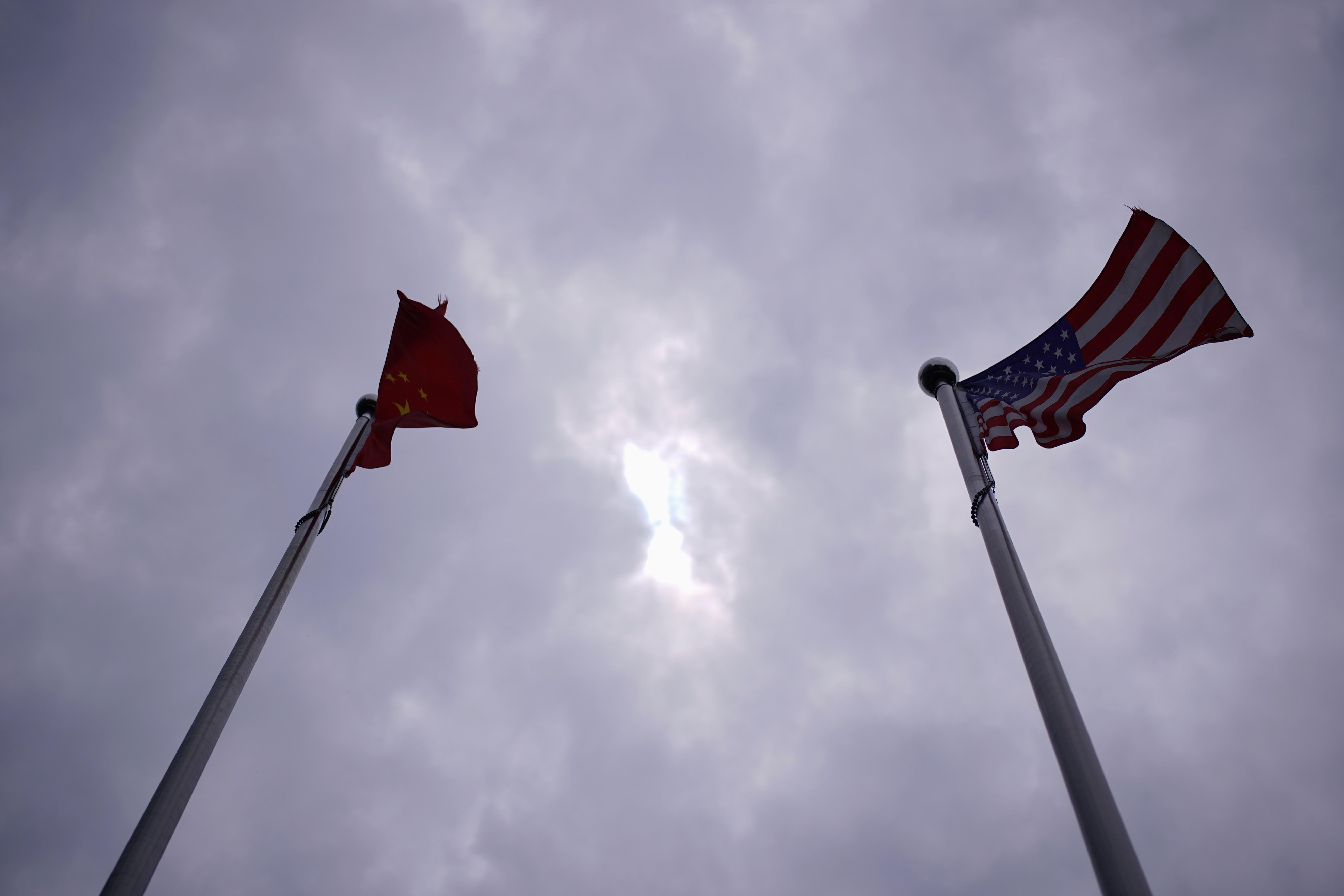 Chinese and U.S. flags flutter in Shanghai, China June 3, 2020. Aly Song