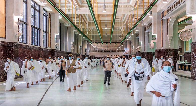Muslim pilgrims walk at the Grand mosque, July 29, <span dir=
