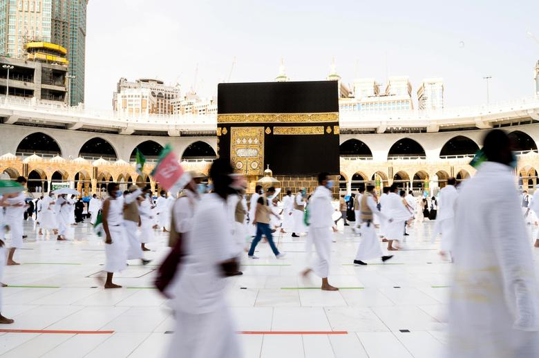 Muslim pilgrims wearing face masks and keeping social distance perform Tawaf around Kaaba during the annual Haj pilgrimage in the holy city of Mecca, Saudi Arabia July 31, <span dir=