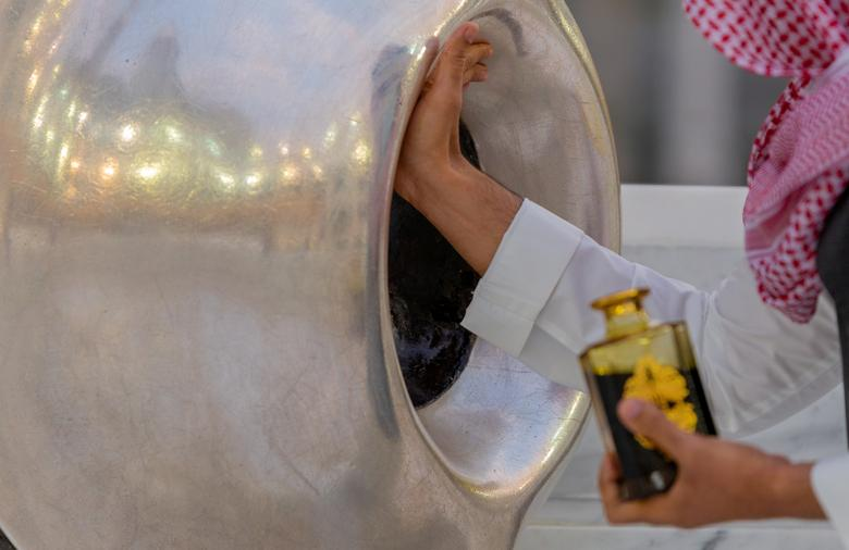 A Muslim man perfumes the Muslim holy Black Stone at the Grand mosque, July 26, <span dir=
