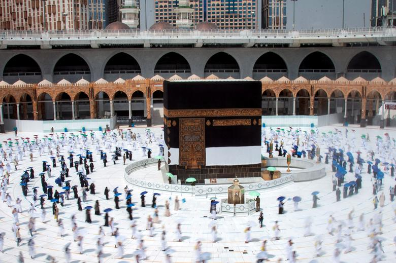 Muslim pilgrims maintain social distancing as they circle the Kaaba at the Grand mosque, July 29, <span dir=