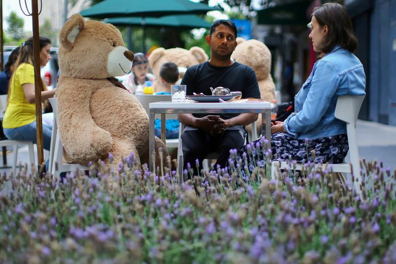 Teddy bears are placed at tables to maintain social distancing measures at Jaso Bakery restaurant in Mexico City, Mexico July 23, 2020. REUTERS/Edgard Garrido