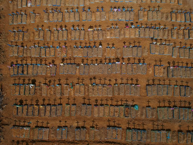 An aerial view of crosses casting shadows at the Parque Taruma cemetery in Manaus, Brazil, June 15. REUTERS/Bruno Kelly