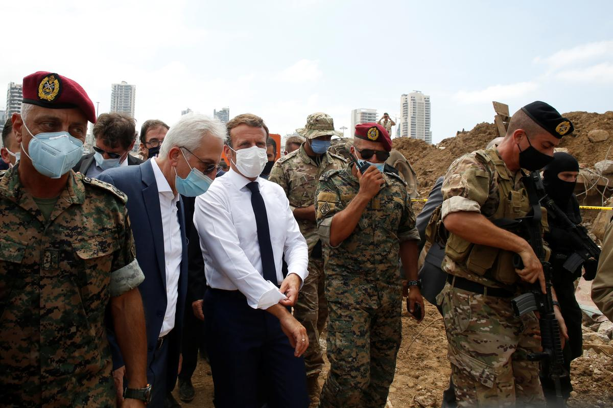 Macron vows to help mobilize aid for Lebanon after devastating blast, warns on reforms
