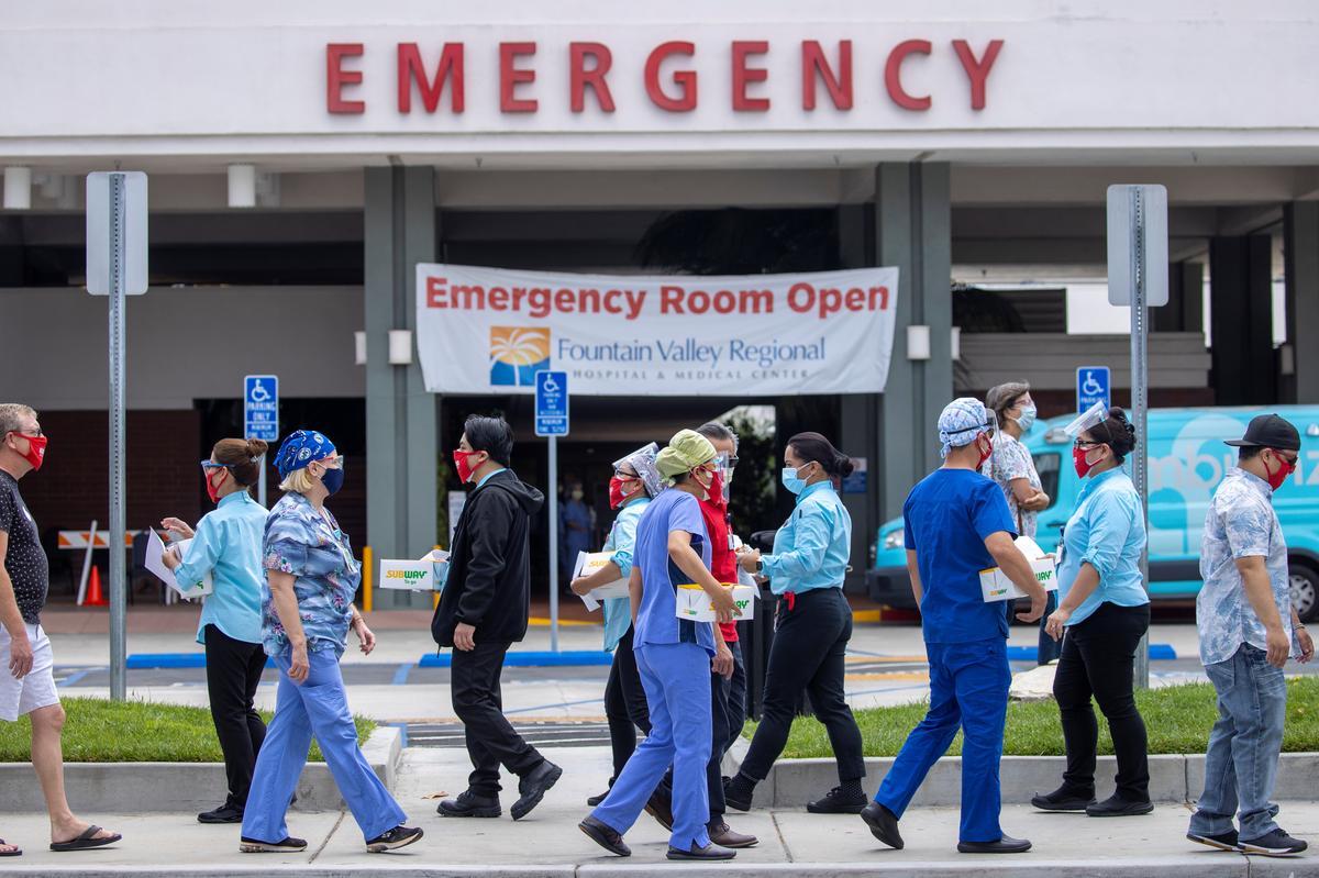 U.S. sets record as coronavirus cases top 5 million