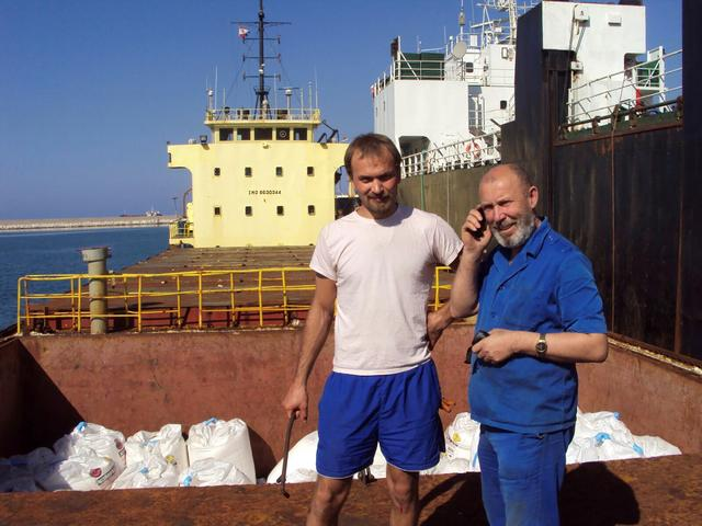 FILE PHOTO: Boris Prokoshev (R), captain of cargo vessel Rhosus, and boatswain Boris Musinchak pose next to a freight hold loaded with ammonium nitrate in the port of Beirut, Lebanon, in a summer 2014 photograph. Picture taken in summer 2014. REUTERS/Personal archives of Boris Musinchak/File Photo