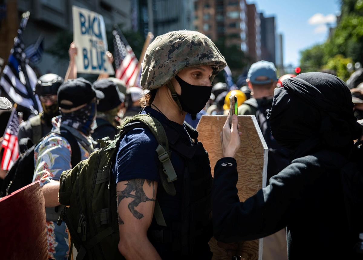 Portland police order protesters to disperse – Reuters