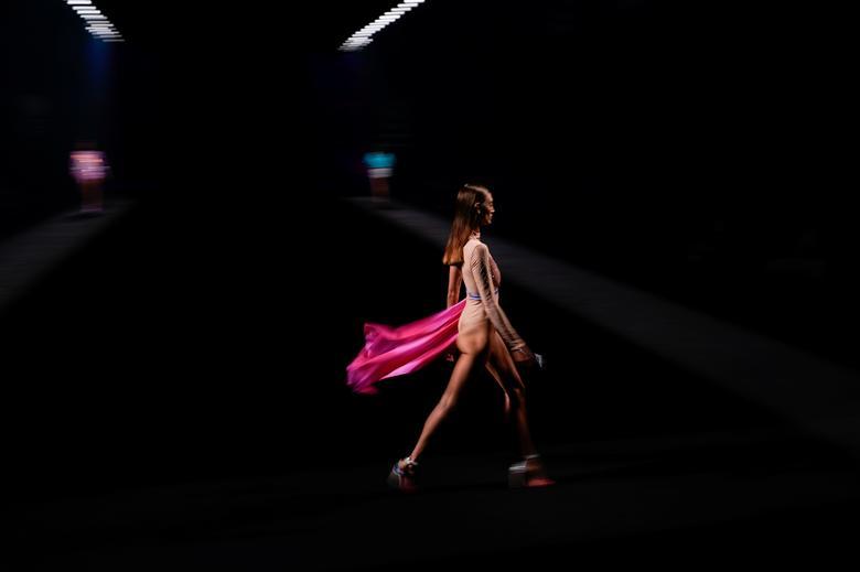 Models present creations by Custo Barcelona. REUTERS/Juan Medina