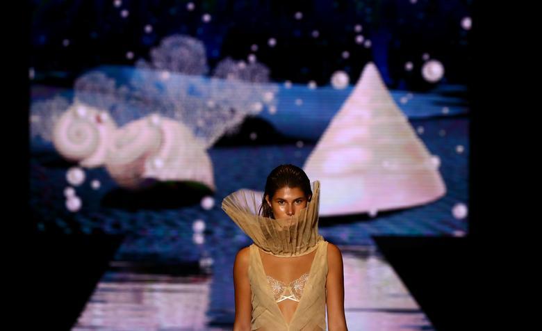 A model presents a creation by designer Andres Sarda. REUTERS/Sergio Perez