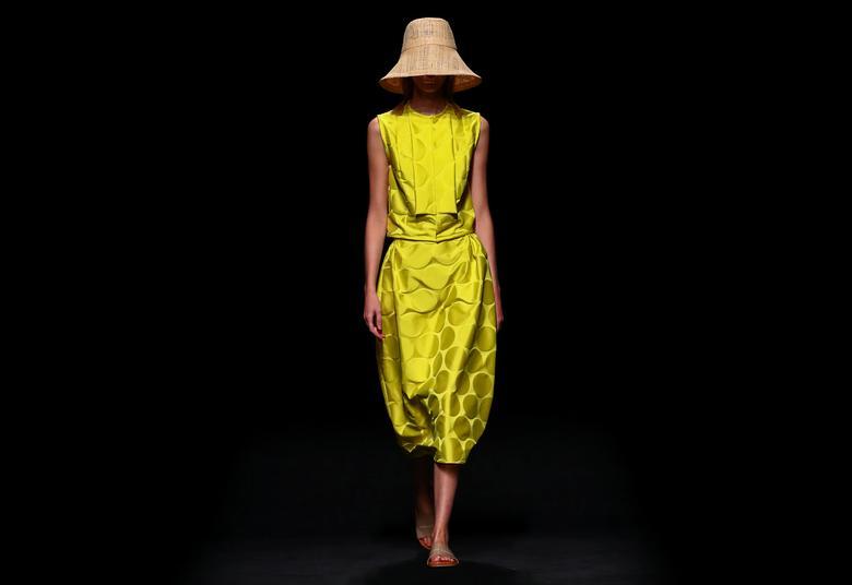 A model presents a creation by Devota & Lomba. REUTERS/Sergio Perez