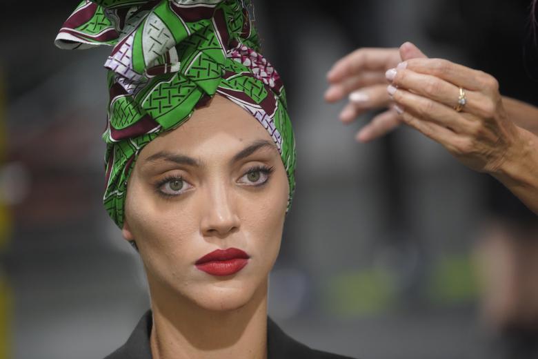 A model is seen on the backstage before the Agatha Ruiz de la Prada show. REUTERS/Juan Medina