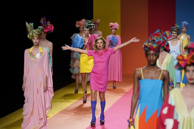 Spanish designer Agatha Ruiz de la Prada at the end of her collection show. REUTERS/Juan Medina