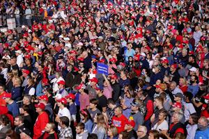 Supporters, many maskless, jam Trump rallies