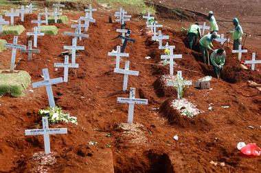 FILE PHOTO: Cemetery in Indonesia's capital running out of space as...