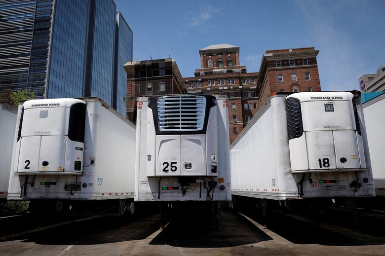 A temporary morgue set up with refrigerated trucks to store the bodies of deceased people is seen next to Bellevue Hospital in Manhattan, New York, May 27. REUTERS/Mike Segar
