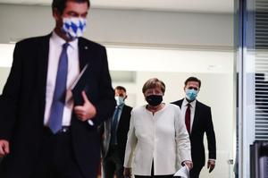 German Chancellor Angela Merkel and Bavarian federal Prime Minister Markus...