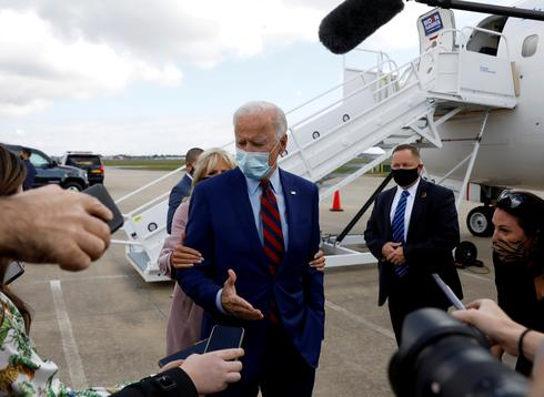Biden cautiously campaigns as COVID cases rise