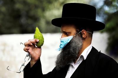 Jewish faithful celebrate Sukkot with masks, social distancing