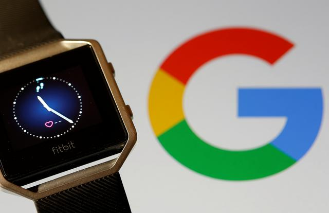 FILE PHOTO: Fitbit Blaze watch is seen in front of a displayed Google logo in this illustration picture taken, November 8, 2019. REUTERS/Dado Ruvic