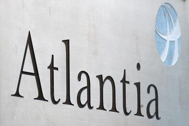 FILE PHOTO: The logo of an infrastructure group Atlantia is seen outside their headquarters, in Rome, Italy October 5, 2020. REUTERS/Guglielmo Mangiapane