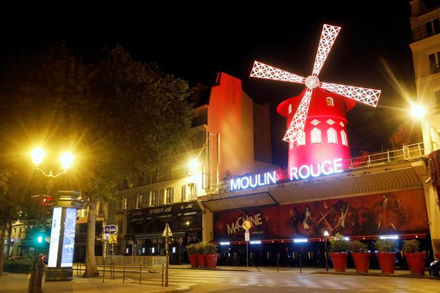 A view shows empty streets around the Moulin Rouge cabaret during the late-night curfew due to restrictions against the spread of the coronavirus disease (COVID-19) in Paris, France, October 17, 2020. REUTERS/Charles Platiau