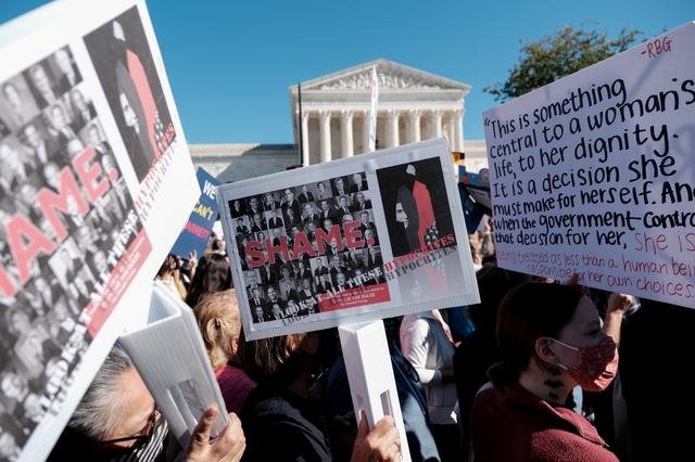 Women's March activists participate in a nationwide protest against U.S. President Donald Trump's decision to fill the seat on the Supreme Court left by the late Justice Ruth Bader Ginsburg before the 2020 election, in Washington, U.S., October 17, 2020. REUTERS/Michael A. McCoy