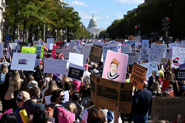 People participate in a nationwide protest against U.S. President Donald Trump's decision to fill the seat on the Supreme Court left by the passing of late Justice Ruth Bader Ginsburg before the 2020 election, in Washington, U.S., October 17, 2020. REUTERS/Erin Scott