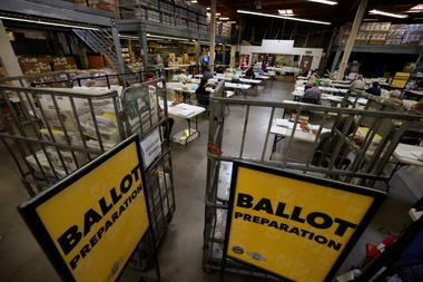 FILE PHOTO: Some of the hundreds of thousands of early mail-in ballots are...