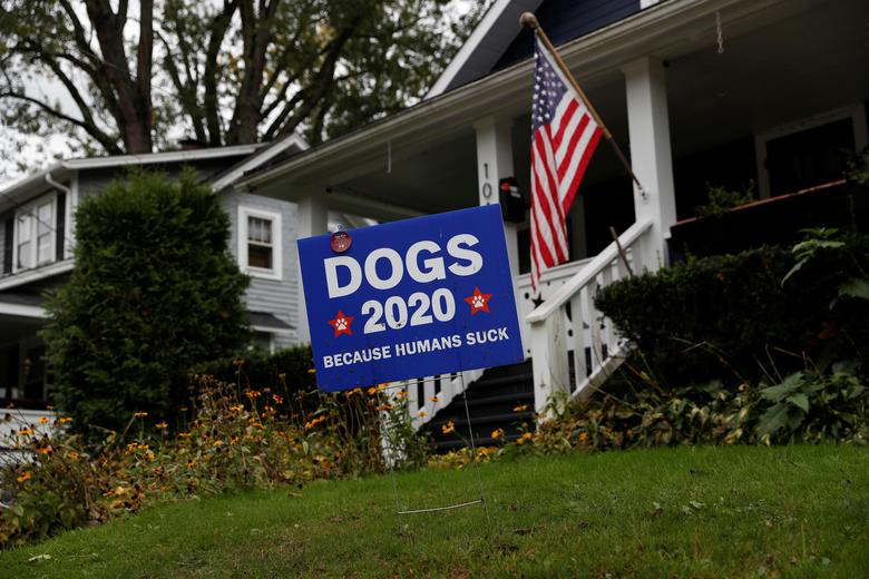 A sign referencing the presidential election sits in the front yard of a home in Chagrin Falls, Ohio, September 29, 2020. REUTERS/Shannon Stapleton